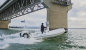 6.1m Sport RIB going under the Auckland Harbour Bridge